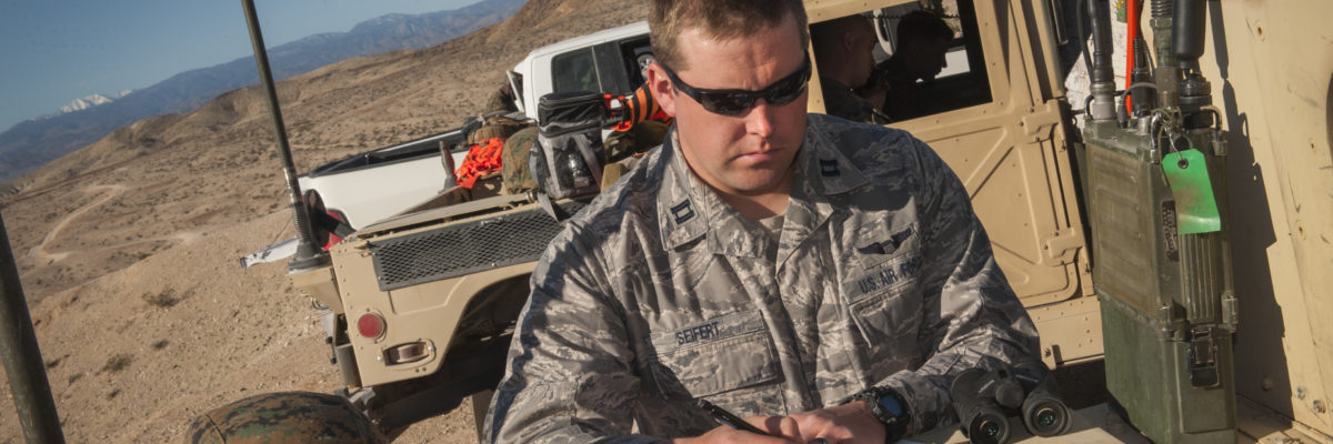 Capt. Bradley Siefert, 69th Bomb Squadron pilot, takes notes during Integrated Training Exercise 2-15 on Marine Corps Air Ground Combat Center Twentynine Palms, Calif., Feb. 12, 2015. Aircrews from the 69th BS provided close-air support to Marine ground units during the exercise. (U.S. Air Force photo/Airman 1st Class Apryl Hall)
